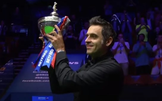 Ronnie O'Sullivan lifting a trophy