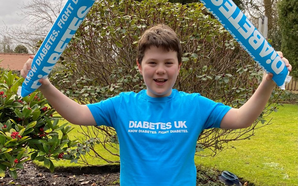 Malachy Hatton, wearing a Diabetes UK t-shirt, is triumphant after completing his run