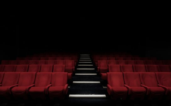 empty cinema with red seats