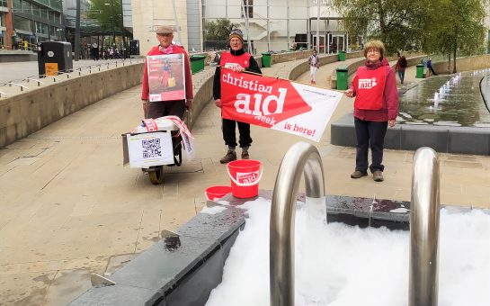 Christian Aid supporters with wheelbarrow