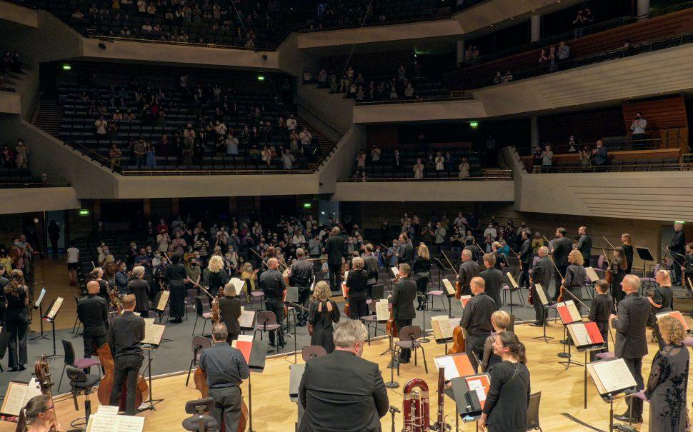 The Hallé and Sir Mark Elder receive a standing ovation on their return to live performance © The Hallé