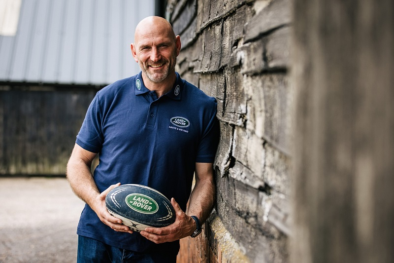 Lawrence Dallaglio holding a Land Rover rugby ball