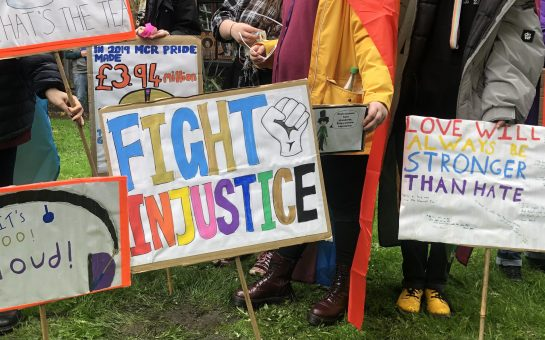 Placards at 'Reclaim Pride' protest