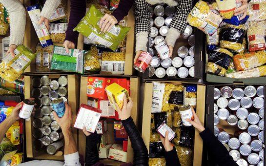 Volunteers sorting food items at a food bank