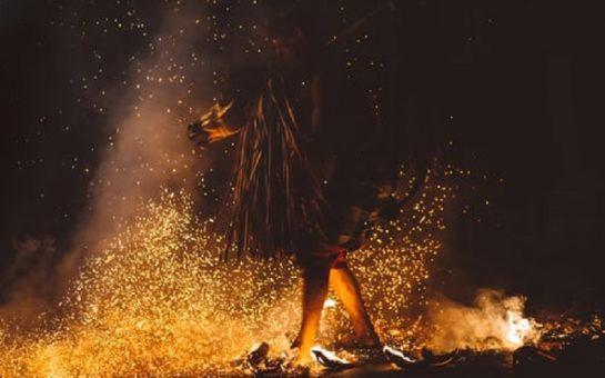 fundraisers firewalking across hot coals
